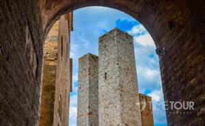 Wycieczka szkolna do Włoch - wieże w San Gimignano w Toskanii